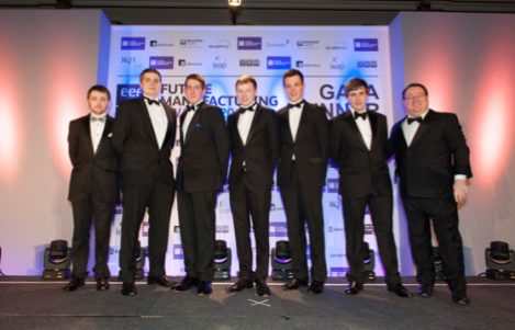 Lewis Guy (second on the left) is standing with the other finalist and with Declan Curry (far right) BBC Business Correspondent and Presenter who was the Master of Ceremonies for the evening.