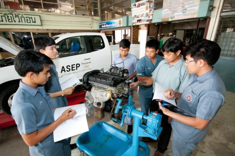 Students from the Chevrolet ASEP educate themselves about the Duramax engine in the Colorado that was donated to the institution