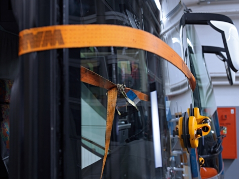 Tensioning straps help to secure the new windscreen during the drying phase.