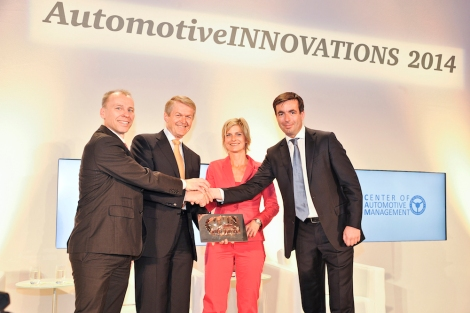 Prof. Dr. Thomas Weber, Member of the Board of Daimler AG, responsible for Group Research and Mercedes-Benz Cars Development receiving the Automotive Innovations Award 2014. The award was presented by Prof. Dr. Stefan Bratzel, Center of Automotive Management and Felix Kuhnert, Automotive Germany and Europe PricewaterhouseCoopers.