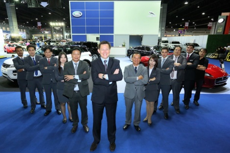 Danai Chandrangam, General Manager, City Automobiles Co.,Ltd together with his sales team at the Jaguar Land Rover booth at 5th Supercar and Import Car Show, Impact Muang Thong Thani