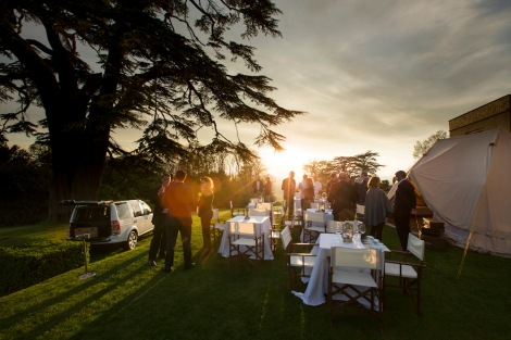 Guests enjoy Tanzanian culinary delights in the outdoor safari-themed setting of Hedsor House.
