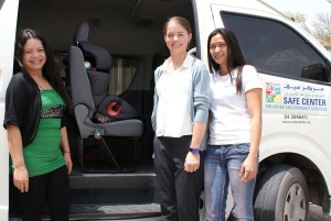 Jona Jarmin, Kate Grimes, and Joanee Ferrer from the SAFE Centre with car seats donated by Chevrolet