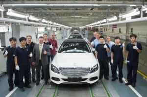 Frank Deiss (fourth from left), President and CEO Beijing Benz Automotive (BBAC), with team-members at the production line, celebrating the first Mercedes-Benz Long-wheelbase C-Class in Beijing.