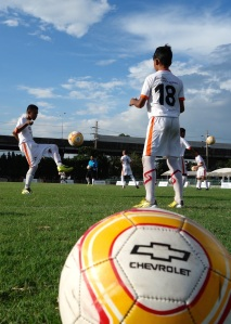 "Participants in Chevrolet's ""Play for Dreams"" Football Academy were tested for their football skills, including passing, heading, dribbling, shooting and teamwork."