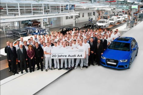 The first Audi A4 produced at Audi's main plant in Ingolstadt drove off the assembly line in October 1994. The employees and management are proud of the most successful Audi model of all time. Picture: Chairman of Audi's General Works Council Peter Mosch (front right near the Audi RS 4), Plant Director Peter Kössler (front, second from the right) and Peter Hochholdinger, Head of Production A4/A5/Q5 Ingolstadt (rear left) with A4 assembly employees.