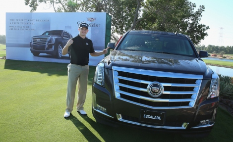 Tom Lewis of England celebrates after his hole-in-one on the seventh hole earned him a car during the first round of the Abu Dhabi HSBC Golf Championship at the Abu Dhabi Golf Cub on January 15, 2015 in Abu Dhabi, United Arab Emirates.