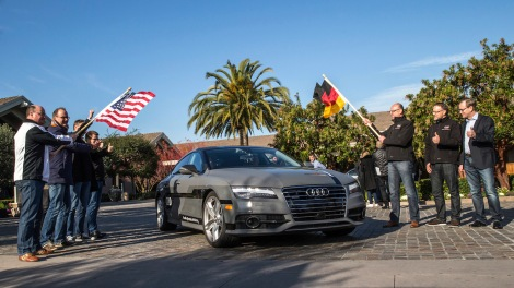Start of the 550 mile piloted drive from Silicon Valley to Las Vegas: Ricky Hudi, Executive Vice President Electric/Electronic Development, (left) and Ewald Gössmann, Executive Director Electronic Research Lab California (ERL), (third from right) drop the flag for the Audi A7 piloted driving concept car.