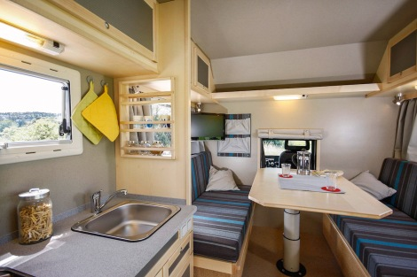 The centrepiece of the Bimobil EX 460's camper body is a group of seats for four people behind the cab. A lockable passage connects the cab to the body.