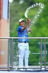 VIRGINIA WATER, ENGLAND - MAY 24:  Byeong-Hun An of South Korea celebrates with champagne following his victory during day 4 of the BMW PGA Championship at Wentworth on May 24, 2015 in Virginia Water, England.  (Photo by David Cannon/Getty Images)