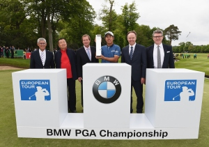 VIRGINIA WATER, ENGLAND - MAY 24:  Byeong-Hun An of South Korea poses with the trophy and (L-R) David Williams, Chairman of The European Tour, Dr Chanchai Ruayrungruang, Chairman of Reignwood Group, European Tour Chief Executive George O'Grady, Dr Ian Robertson, Member of the Board BMW AG Sales and Marketing and Graeme Grieve, Chief Executive Officer of BMW Group UK and Ireland following his victory during day 4 of the BMW PGA Championship at Wentworth on May 24, 2015 in Virginia Water, England.  (Photo by Ross Kinnaird/Getty Images)