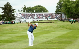 VIRGINIA WATER, ENGLAND - MAY 24:  Byeong-Hun An of South Korea hits his 3rd shot on the 18th hole during day 4 of the BMW PGA Championship at Wentworth on May 24, 2015 in Virginia Water, England.  (Photo by Warren Little/Getty Images)