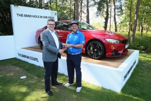 VIRGINIA WATER, ENGLAND - MAY 21:  Andrew Johnston of England is given the keys to his new BMW M4 Coupe by Graeme Grieve, Chief Executive of BMW Group UK and Ireland after his hole-in-one on the 10th hole during day 1 of the BMW PGA Championship at Wentworth on May 21, 2015 in Virginia Water, England.  (Photo by Andrew Redington/Getty Images)