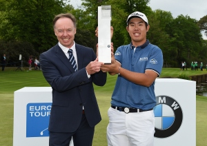 VIRGINIA WATER, ENGLAND - MAY 24:  Byeong-Hun An of South Korea poses with the trophy and Dr Ian Robertson, Member of the Board BMW AG Sales and Marketing after day 4 of the BMW PGA Championship at Wentworth on May 24, 2015 in Virginia Water, England.  (Photo by Ross Kinnaird/Getty Images)
