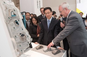 During a tour at the Volkswagen Group Forum DRIVE in Berlin Prof. Dr. Martin Winterkorn, Chairman of the Board of Management of Volkswagen Aktiengesellschaft, explains Han Zheng, Party Secretary of the City of Shanghai and member of the Politburo of the Communist Party of China, the advantages and the use of lightweight construction material in the Volkswagen production.